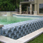 Tile modules designed and made by Eric Pilhofer for Lake Minnetonka, MN swimming pool. Bread and Roses Remodeling consulted, supplied materials, and assisted with installation.